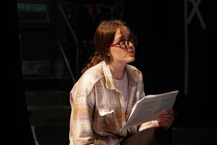 girl reading from script