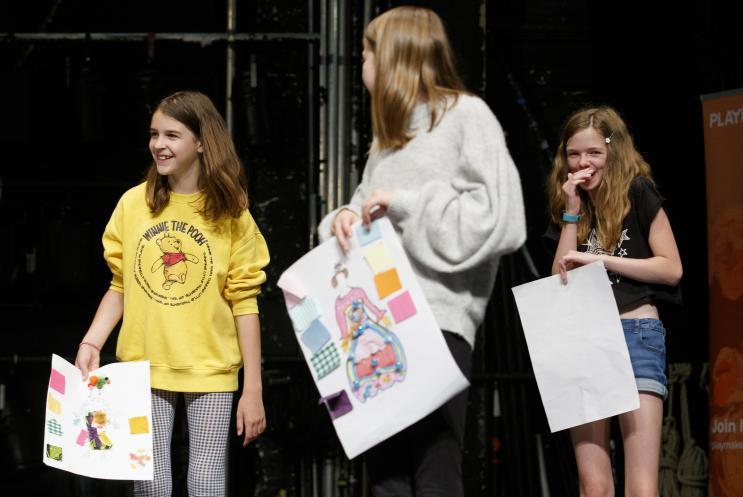 children presenting designs