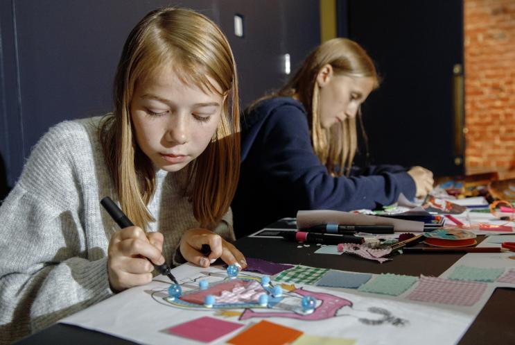 girls drawing costume designs