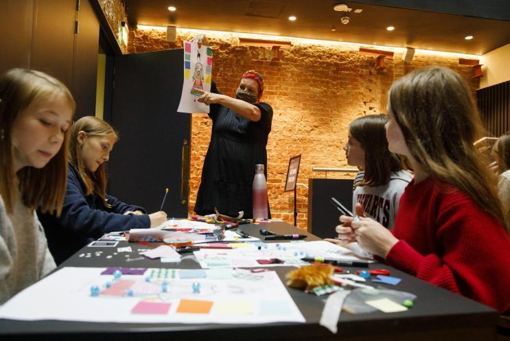 workshop leader showing design