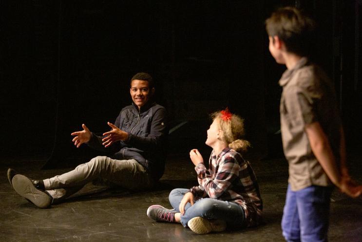 children chatting on stage