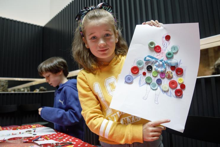 girl showing her design