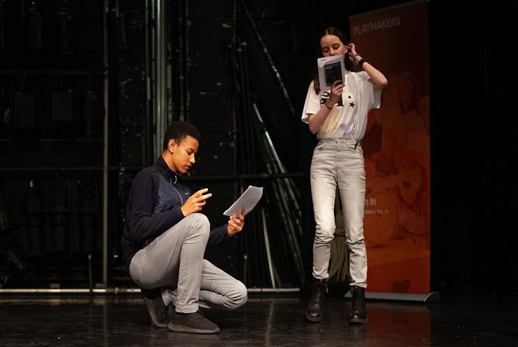 boy and girl reading from scripts